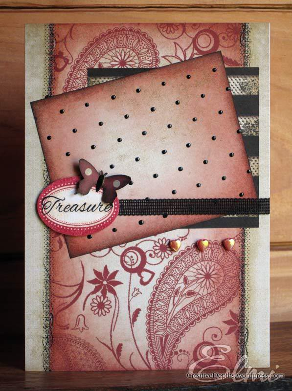 Vintage card with pink, black and cream paper, a butterfly, and a tag with the word Treasure on